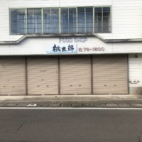A closed-down grocery store in Fujisato, Akita Prefecture, in November | YING ZHOU
