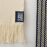 Maekake aprons made by Anything Co. Ltd. use a thicker yarn to produce a textured weave, and have braided straps crafted in Hiroshima Prefecture. | HIROYUKI HARA