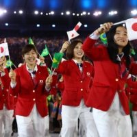 Japan's Olympic delegation attends the opening ceremony of the 2016 Games in Rio de Janeiro. The number of Japanese athletes participating in the Olympic ceremonies in Tokyo is expected to be limited.   REUTERS
