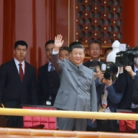 Chinese President Xi Jinping waves next to Premier Li Keqiang and former president Hu Jintao at the end of the event marking the 100th founding anniversary of the Communist Party of China, at Tiananmen Square in Beijing on Thursday.  | REUTERS