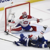 Lightning center Blake Coleman (left) scores past Canadiens goalie Carey Price in the second period of Game 2 of the Stanley Cup Final in Tampa, Florida. | USA TODAY / VIA REUTERS