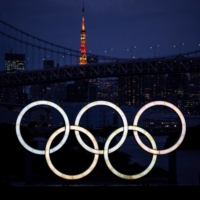 The Olympic rings are seen on the Odaiba waterfront at dusk on June 23. | AFP-JIJI