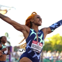 Sha'Carri Richardson celebrates after winning the women's 100-meter race at the U.S. trials in Eugene, Oregon, on June 19.   USA TODAY / VIA REUTERS