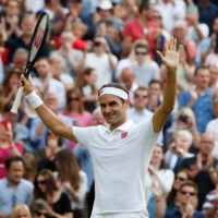 Roger Federer celebrates after defeating Richard Gasquet in the second round at Wimbledon in London on Wednesday. | REUTERS