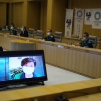 Following a brief hiatus to recover after being hospitalized due to fatigue, Tokyo Gov. Yuriko Koike attends a meeting online at the Tokyo Metropolitan Government building on Thursday. | RYUSEI TAKAHASHI