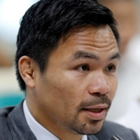 Philippine Senator and boxing star Manny Pacquiao speaks during a congressional confirmation hearing in Manila. | REUTERS