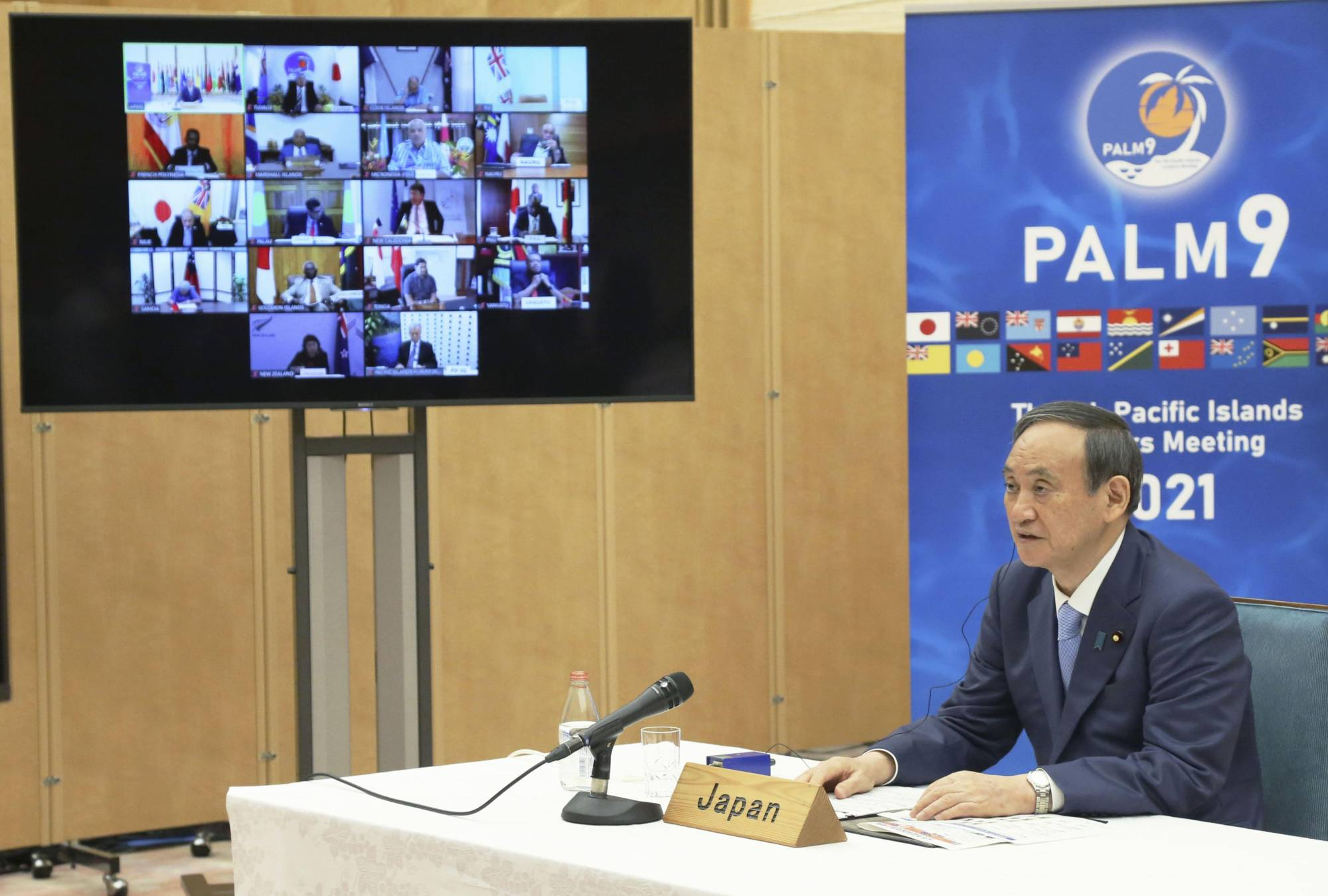 Prime Minister Yoshihide Suga addresses an online meeting with leaders of Pacific island nations and territories on Friday at the Prime Minister's Office. | KYODO