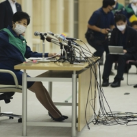 Tokyo Gov. Yuriko Koike speaks at a news conference on Friday, the first time she has spoken in person with the media after she was hospitalized for fatigue. | RYUSEI TAKAHASHI