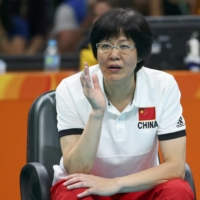 China head coach Lang Ping instructs her team during the women's volleyball gold medal match at the 2016 Rio Olympics. | REUTERS