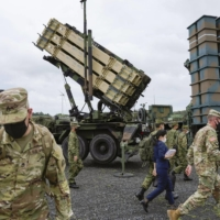 A PAC-3 ground-based missile defense system is deployed at Camp Amami on the island of Amami-Oshima in Kagoshima Prefecture for the first time, during joint U.S.-Japan Orient Shield 21 military drills on Thursday. | KYODO