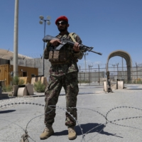 An Afghan National Army soldier stands guard at Bagram Air Base, after all U.S. and NATO troops left, some 70 km north of Kabul, on Friday. | AFP-JIJI