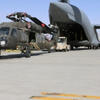 A UH-60L Blackhawk helicopter is loaded onto a U.S. Air Force C-17 Globemaster III during the withdrawal of American forces in Afghanistan on June 16. | U.S. ARMY / REUTERS