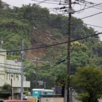 An area of Zushi, Kanagawa Prefecture, was hit by a landslide due to heavy rain.  | KYODO