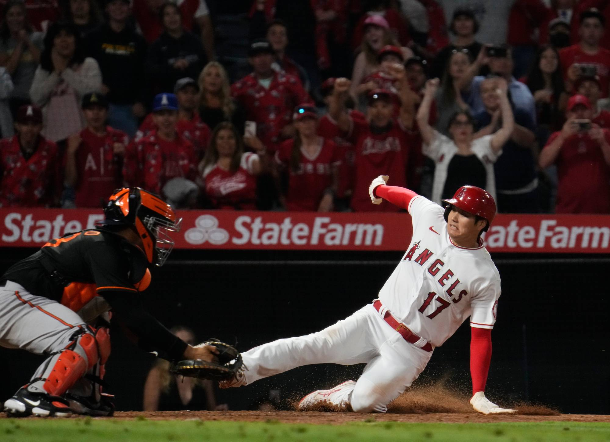 Los Angeles Angels designated hitter Shohei Ohtani slides into home to score the winning run in the bottom of the ninth inning against the Baltimore Orioles on Friday at Angel Stadium.    USA TODAY / VIA REUTERS