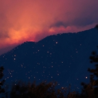 A wildfire burns above the Fraser River Valley near Lytton, British Columbia, Canada, on Friday.   BLOOMBERG