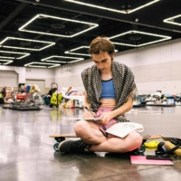 A woman rests at the Oregon Convention Center cooling station in Portland on June 28 amid a heat wave that moved over much of the United States and Canada. | AFP-JIJI
