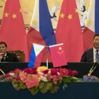 Philippine President Rodrigo Duterte and Chinese President Xi Jinping attend a signing ceremony in Beijing in 2016.  | GETTY IMAGES / VIA BLOOMBERG