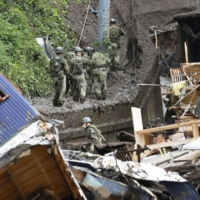 Self-Defense Forces personnel search for the missing in Atami, Shizuoka Prefecture, on Monday after Saturday's mudslides.   KYODO