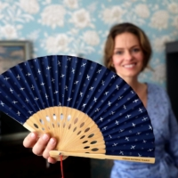 Czech designer Zuzana Osako shows a fan, that comes as an accessory with the Czech Republic's Olympic team outfits, at her studio in Prague on June 29. | REUTERS
