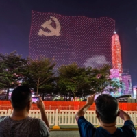 Drones form a flag of the Communist Party of China during a show marking the 100th anniversary of the party's founding, in Shenzhen, Guangdong province, on Thursday.  | AFP-JIJI