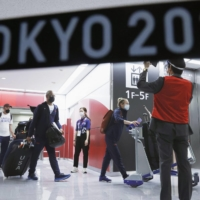 Members of the U.S. Olympic team arrive at Narita Airport on Thursday.   KYODO