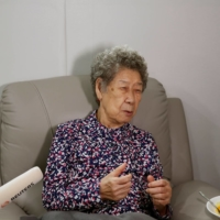 Former South Korean 'comfort woman' Kang Il-chul speaks during an interview at the House of Sharing in Gwangju-si, Gyeonggi-do, South Korea, on May 4. | REUTERS