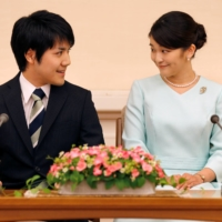 Kei Komuro and Princess Mako attend a news conference in Tokyo in September 2017.   POOL / VIA REUTERS