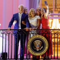 U.S. President Joe Biden, first lady Jill Biden, their daughter Ashley Biden and granddaughters Finnegan and Naomi pose for a picture during Independence Day celebrations in Washington on Sunday.   REUTERS