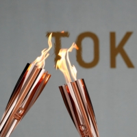 Torches during a torch kiss event, after a relay on a public road was canceled due to the coronavirus pandemic | REUTERS