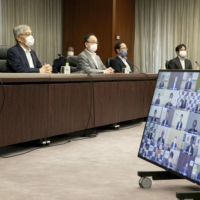 BOJ lowers assessments of two regions as recovery from pandemic slows
