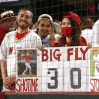A fan holds a sign in support of Shohei Ohtani at Angel Stadium in Anaheim, California, on Friday. | KYODO