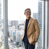 Recruit Holdings CEO Idekoba Hisayuki is posing at the Tokyo headquarters in a recent interview. | Bloomberg