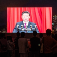 A screen in Hong Kong shows Chinese President Xi Jinping speaking at a light show on July 1 marking the centenary of the Chinese Community Party and the anniversary of Hong Kong's return to Chinese rule.    BLOOMBERG