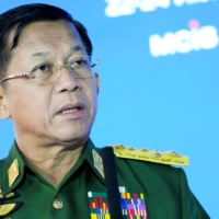 Myanmar junta chief Senior Gen. Min Aung Hlaing delivers a speech at the 9th Moscow Conference on International Security, held in Moscow in June.   POOL / VIA REUTERS