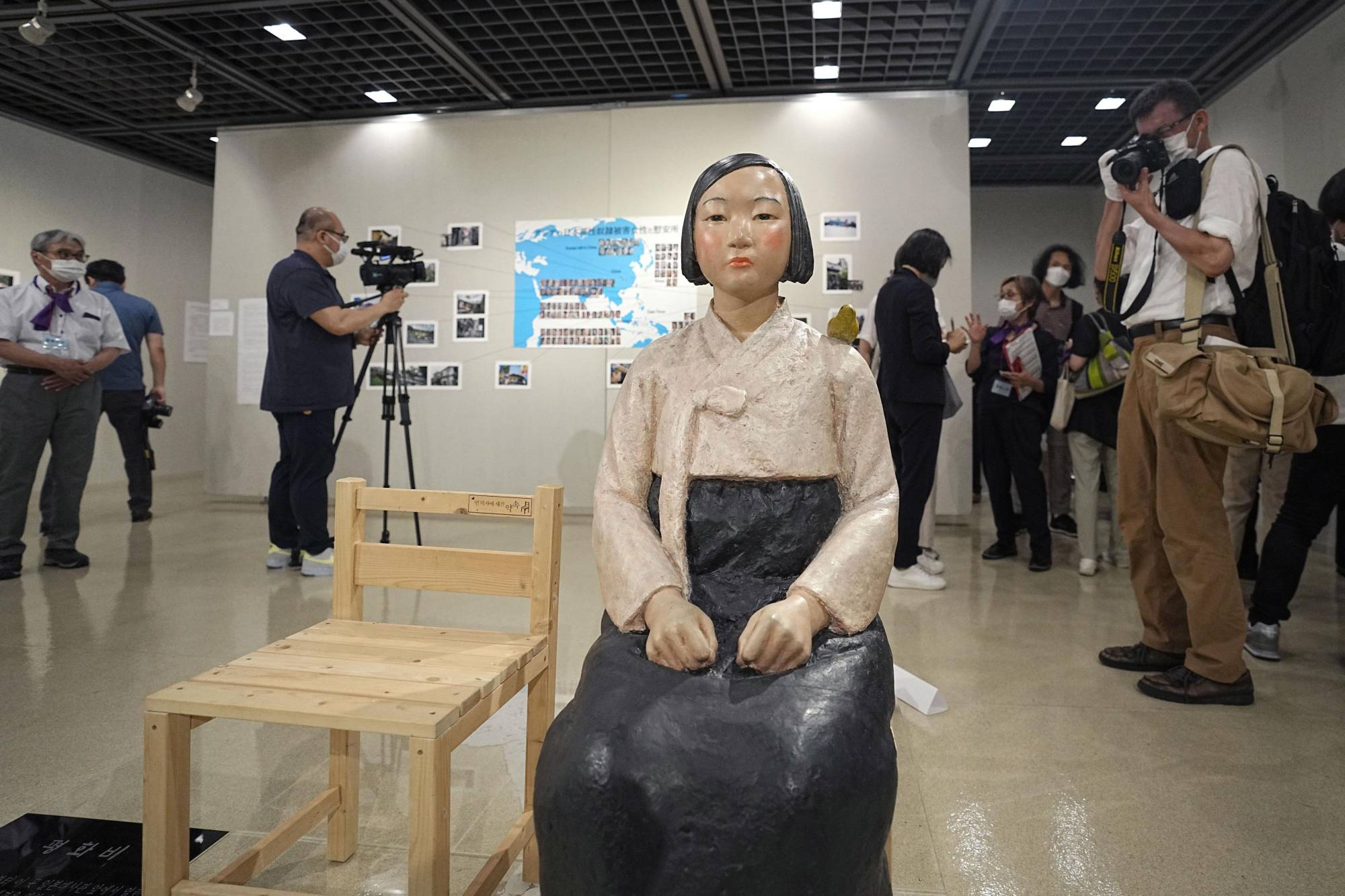 A statue symbolizing 'comfort women' is put on display at an art exhibition at the Sakae municipal gallery in Nagoya on Tuesday.  | KYODO