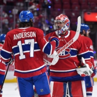 Montreal's Josh Anderson (left) celebrates with goalkeeper Carey Price after scoring the game-winning goal against Tampa Bay in Game 4 of the Stanley Cup Finals on Monday in Montreal. | USA TODAY / VIA REUTERS