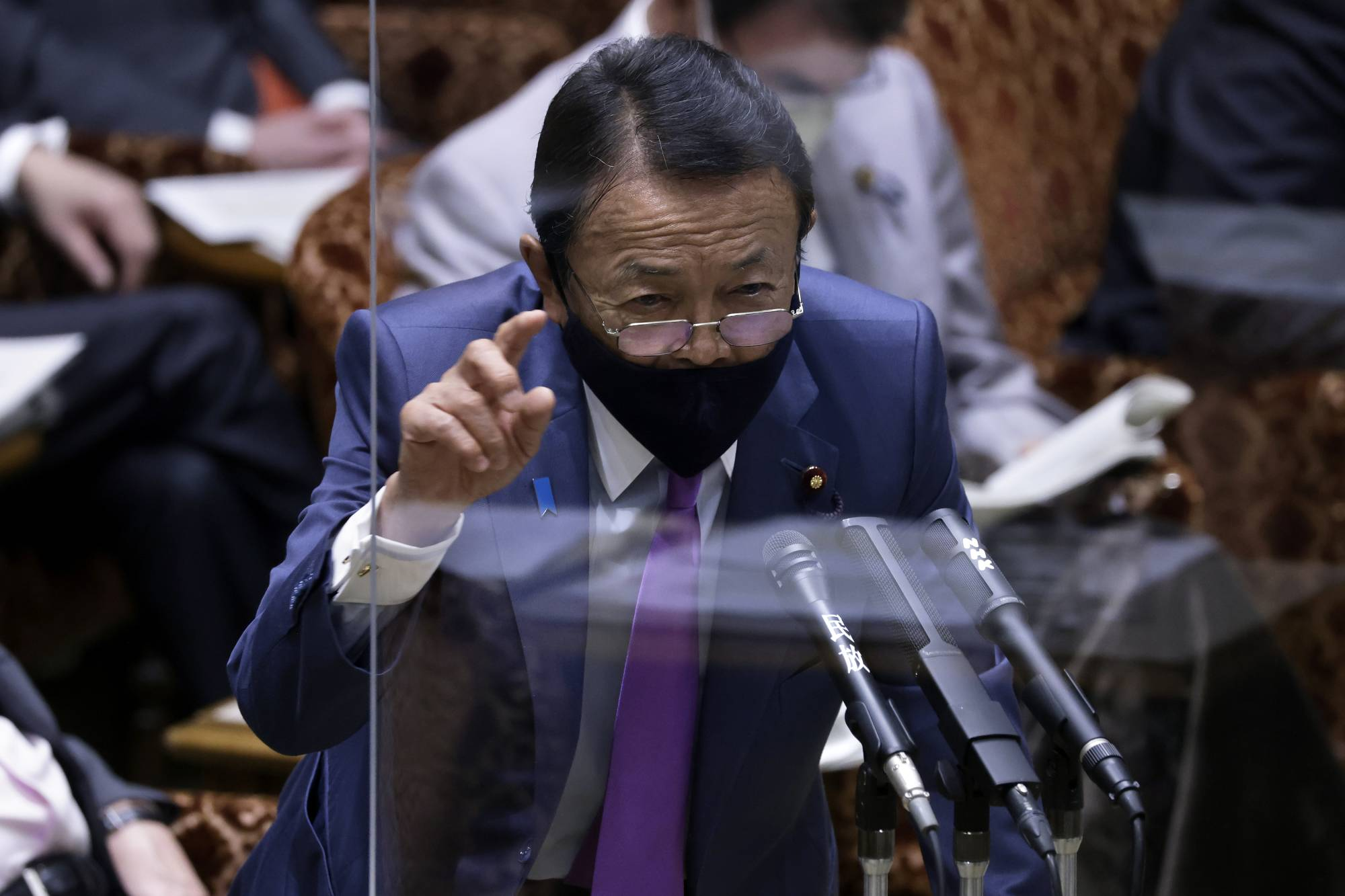 Taro Aso, deputy prime minister and finance minister, speaks during an audit committee session at the Upper House in Tokyo on June 7. | BLOOMBERG