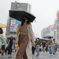 People cross an intersection in Tokyo's Shinjuku Ward on Wednesday.   KYODO