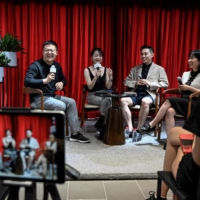 Chinese podcasters (left to right) Yang Yi, Xie Ruohan, Meng Chang and Wang Qing attend a forum with podcast fans at a Beijing bookstore.    AFP-JIJI