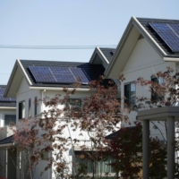 Solar panels sit on the rooftops of smart homes developed by Toyota Motor Corp. in the city of Toyota, Aichi Prefecture. Japan is studying how to lower its dependence on dirty fossil fuels as it grapples with limited available space and a large anti-nuclear contingent. | BLOOMBERG