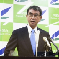 Taro Kono, minister in charge of vaccine rollout, speaks at a news conference in Tokyo on Tuesday. | KYODO