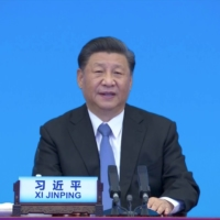 Chinese leader Xi Jinping speaks via video link at the CPC and World Political Parties Summit, held to commemorate the 100th founding anniversary of Communist Party of China, in Beijing in this still image taken from a video Tuesday.    CCTV / VIA REUTERS