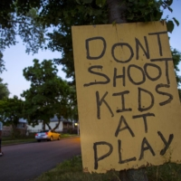 This sign was put up by residents in the Englewood area of Chicago in the hopes of reducing the high incidence of gun violence in the neighborhood. | REUTERS
