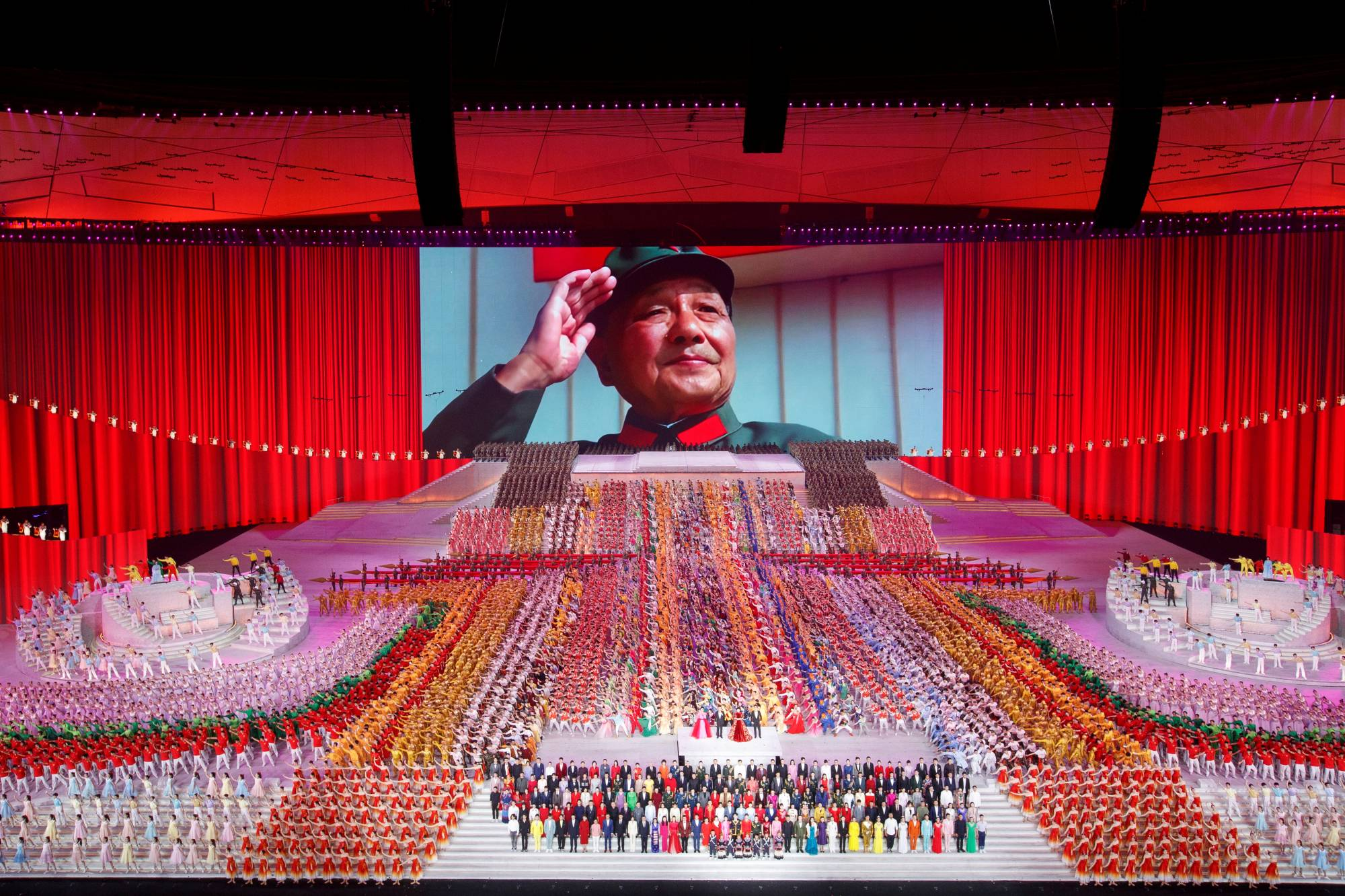 Former Chinese leader Deng Xiaoping, credited with launching China's economic miracle, is honored last month during a show in Beijing commemorating the 100th anniversary of the founding of the Chinese Communist Party.  | REUTERS