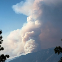 A wildfire burns above the Fraser River Valley near Lytton, British Columbia, on Friday, July 2. | BLOOMBERG