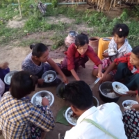 People displaced by violence in the town of Depayin, in Myanmar's Sagaing region, eat together on July 2. | REUTERS