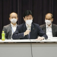 Yasutoshi Nishimura, economic revitalization and virus policy minister, speaks at a meeting on COVID-19 measures in Tokyo on Thursday. | KYODO