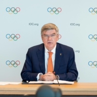 IOC President Thomas Bach speaks during a news conference in Lausanne, Switzerland, on June 10. Bach arrived in Japan on Thursday for the Tokyo Olympics.   IOC / HANDOUT VIA REUTERS