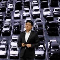Didi Chuxing's CEO Will Wei Cheng speaks at a product launch event in Beijing in November 2020. | REUTERS