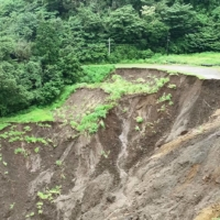 An image taken on Wednesday in Atami, Shizuoka Prefecture, shows a site believed to be where a mudslide started on July 3.   TECHNICAL EMERGENCY CONTROL FORCE / VIA KYODO